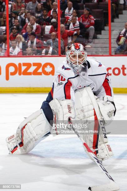 Braden Holtby of the Washington Capitals reaches to corral the puck in a game against the Ottawa Senators at Canadian Tire Centre on October 5 2017...