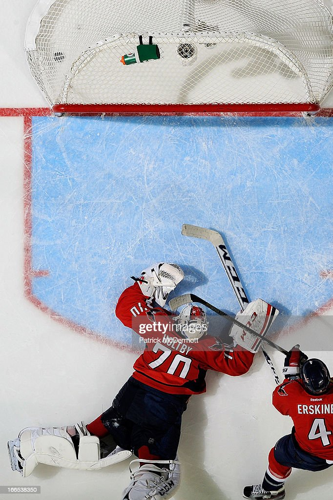 <a gi-track='captionPersonalityLinkClicked' href=/galleries/search?phrase=Braden+Holtby&family=editorial&specificpeople=5370964 ng-click='$event.stopPropagation()'>Braden Holtby</a> #70 of the Washington Capitals reacts after allowing the game tying goal in the third period of an NHL game against the Tampa Bay Lightning at Verizon Center on April 13, 2013 in Washington, DC.