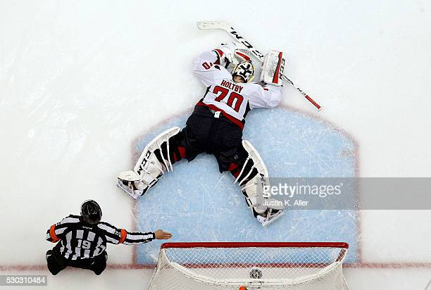 Braden Holtby of the Washington Capitals reacts after allowing the game winning overtime goal against Nick Bonino of the Pittsburgh Penguins in Game...