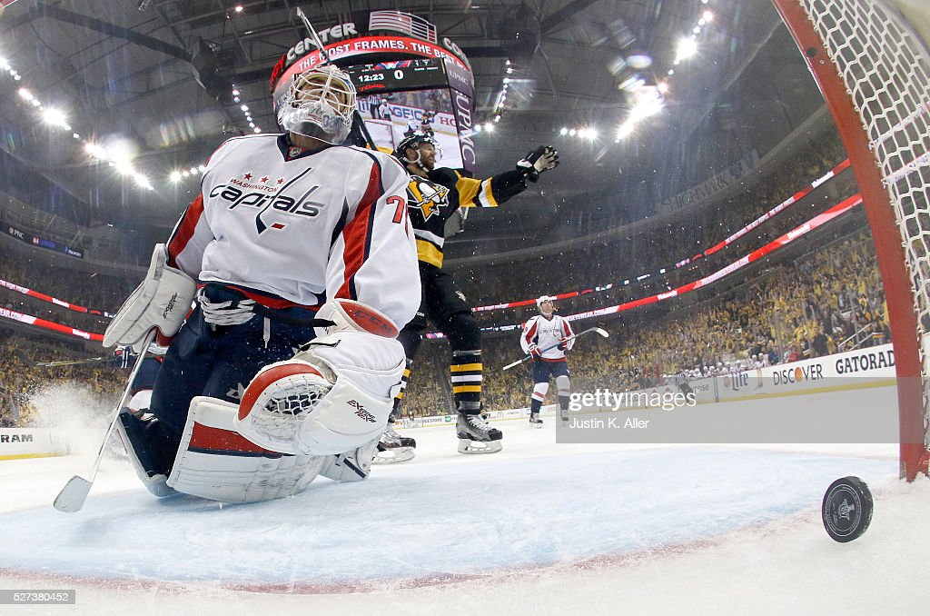 <a gi-track='captionPersonalityLinkClicked' href=/galleries/search?phrase=Braden+Holtby&family=editorial&specificpeople=5370964 ng-click='$event.stopPropagation()'>Braden Holtby</a> #70 of the Washington Capitals reacts after being scored on by Tom Kuhnhackl #34 of the Pittsburgh Penguins (not pictured) in Game Three of the Eastern Conference Second Round during the 2016 NHL Stanley Cup Playoffs at Consol Energy Center on May 2, 2016 in Pittsburgh, Pennsylvania.