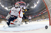 Braden Holtby of the Washington Capitals reacts after being scored on by Tom Kuhnhackl of the Pittsburgh Penguins in Game Three of the Eastern...