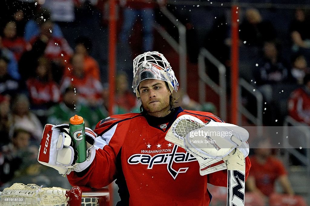 Braden Holtby #70 of the Washington Capitals reacts after giving up a shorthanded goal by Ryan Garbutt (not pictured) of the Dallas Stars in the third period during an NHL game at Verizon Center on April 1, 2014 in Washington, DC.
