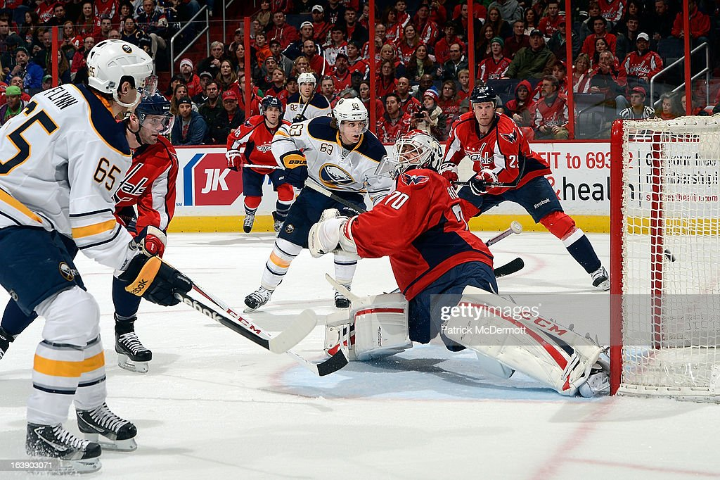 <a gi-track='captionPersonalityLinkClicked' href=/galleries/search?phrase=Braden+Holtby&family=editorial&specificpeople=5370964 ng-click='$event.stopPropagation()'>Braden Holtby</a> #70 of the Washington Capitals reacts as Brian Flynn #65 of the Buffalo Sabres scores a goal during the second period of an NHL game at Verizon Center on March 17, 2013 in Washington, DC.