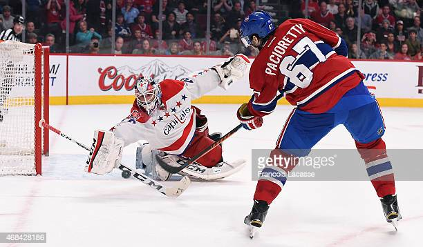 Braden Holtby of the Washington Capitals stops a shot by Max Pacioretty of the Montreal Canadiens in the NHL game at the Bell Centre on April 2 2015...
