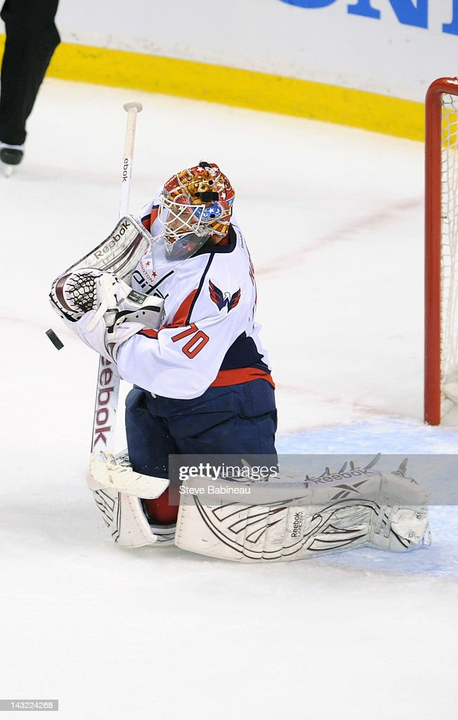 <a gi-track='captionPersonalityLinkClicked' href=/galleries/search?phrase=Braden+Holtby&family=editorial&specificpeople=5370964 ng-click='$event.stopPropagation()'>Braden Holtby</a> #70 of the Washington Capitals stops the puck against the Boston Bruins in Game Five of the Eastern Conference Quarterfinals during the 2012 NHL Stanley Cup Playoffs at TD Garden on April 21, 2012 in Boston, Massachusetts.