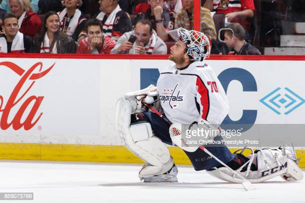 Braden Holtby of the Washington Capitals stretches during a break in a game against the Ottawa Senators at Canadian Tire Centre on October 5 2017 in...