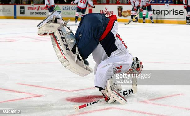 Braden Holtby of the Washington Capitals stretches during pregame warmups prior to the game against the New Jersey Devils at Prudential Center on...