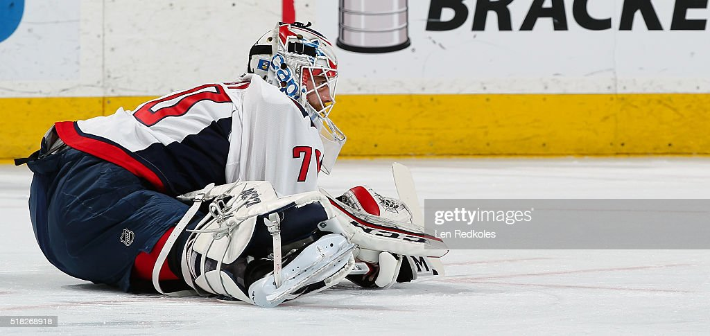 Braden Holtby #70 of the Washington Capitals stretches during warmups prior to his game against the Philadelphia Flyers on March 30, 2016 at the Wells Fargo Center in Philadelphia, Pennsylvania.