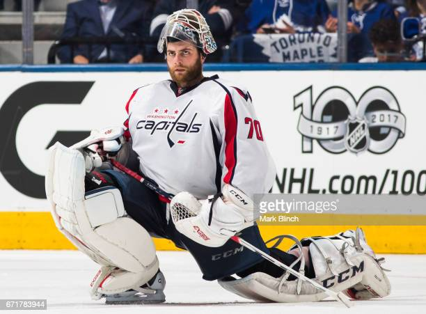 Braden Holtby of the Washington Capitals stretches in a break against the Toronto Maple Leafs during the second period in Game Four of the Eastern...