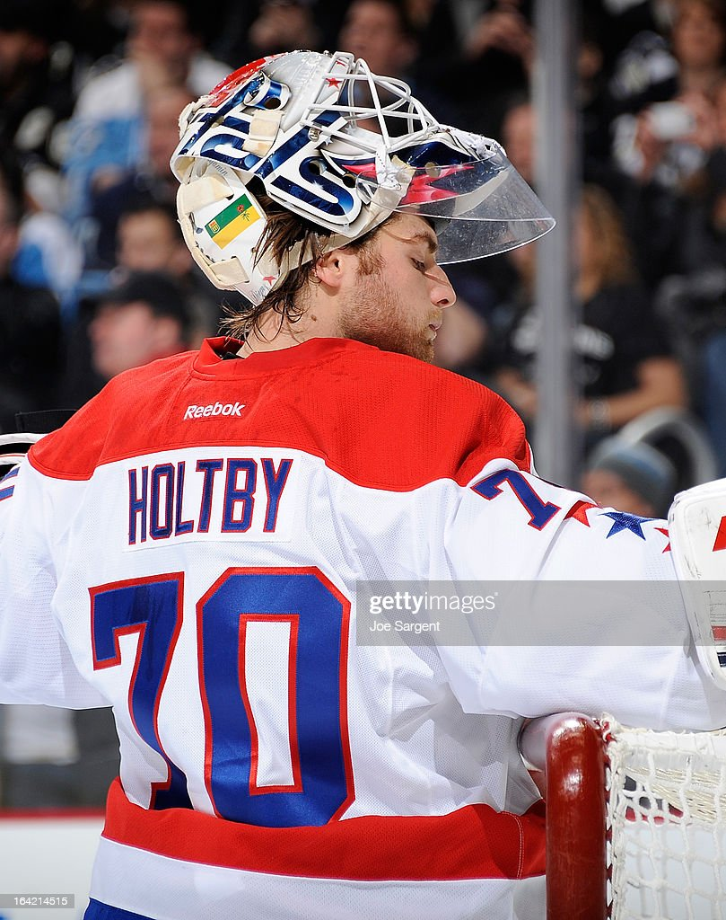 Braden Holtby #70 of the Washington Capitals takes a drink during a timeout against the Pittsburgh Penguins on March 19, 2013 at Consol Energy Center in Pittsburgh, Pennsylvania.