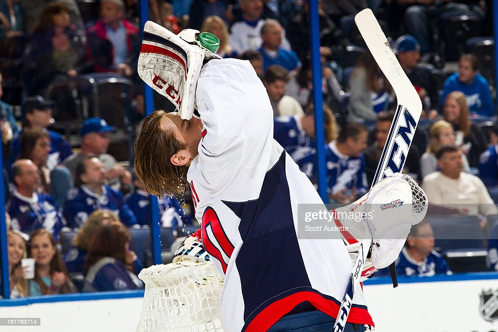 Braden Holtby #70 of the Washington Capitals takes a drink during the first period of the game against the Tampa Bay Lightning at the Tampa Bay Times Forum on February 14, 2013 in Tampa, Florida.
