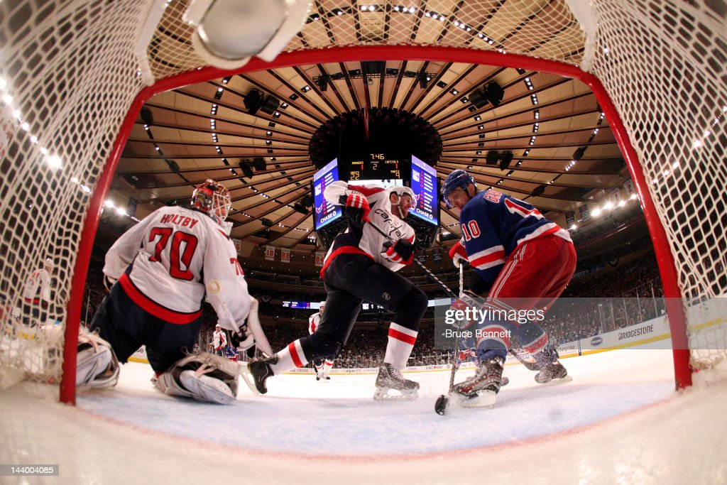 <a gi-track='captionPersonalityLinkClicked' href=/galleries/search?phrase=Braden+Holtby&family=editorial&specificpeople=5370964 ng-click='$event.stopPropagation()'>Braden Holtby</a> #70 of the Washington Capitals tends goal against <a gi-track='captionPersonalityLinkClicked' href=/galleries/search?phrase=Marian+Gaborik&family=editorial&specificpeople=202477 ng-click='$event.stopPropagation()'>Marian Gaborik</a> #10 of the New York Rangers in Game Five of the Eastern Conference Semifinals during the 2012 NHL Stanley Cup Playoffs at Madison Square Garden on May 7, 2012 in New York City.