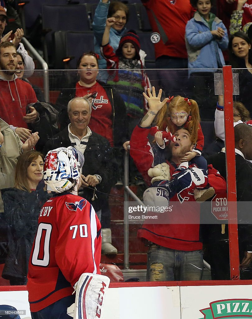 <a gi-track='captionPersonalityLinkClicked' href=/galleries/search?phrase=Braden+Holtby&family=editorial&specificpeople=5370964 ng-click='$event.stopPropagation()'>Braden Holtby</a> #70 of the Washington Capitals tosses a puck to a fan following a 5-1 defeat of the New Jersey Devils at the Verizon Center on February 23, 2013 in Washington, DC.