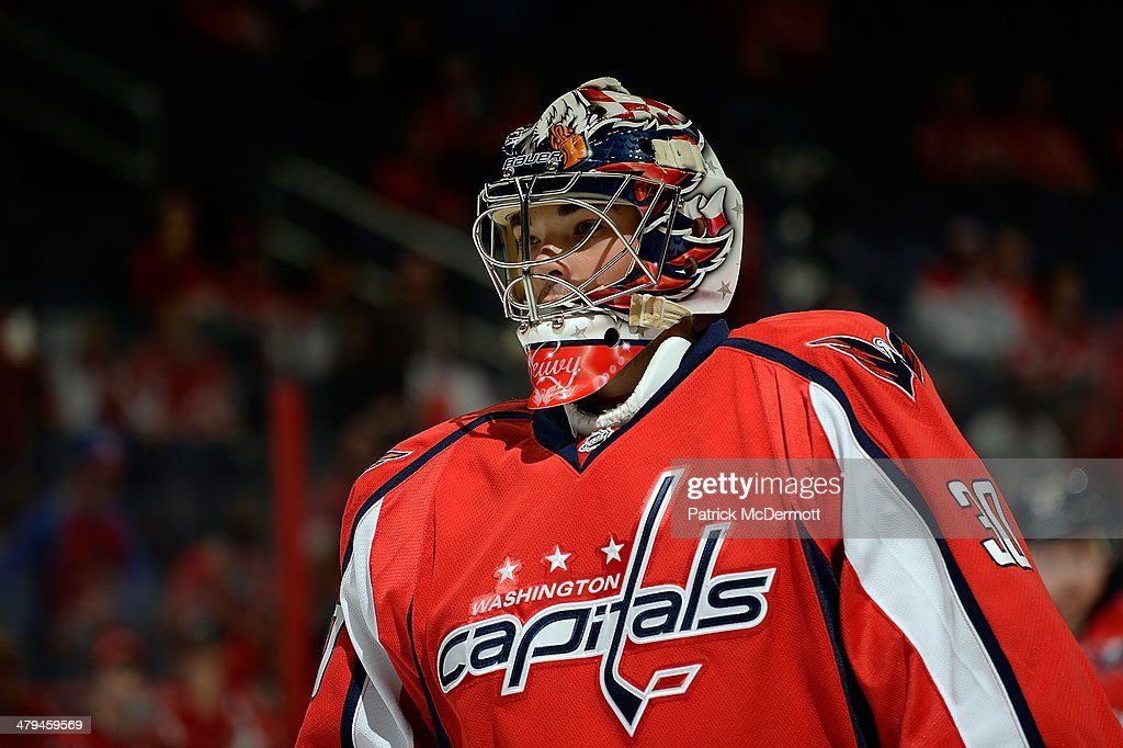<a gi-track='captionPersonalityLinkClicked' href=/galleries/search?phrase=Braden+Holtby&family=editorial&specificpeople=5370964 ng-click='$event.stopPropagation()'>Braden Holtby</a> #70 of the Washington Capitals warms up before an NHL game against the New York Rangers at Verizon Center on October 16, 2013 in Washington, DC.