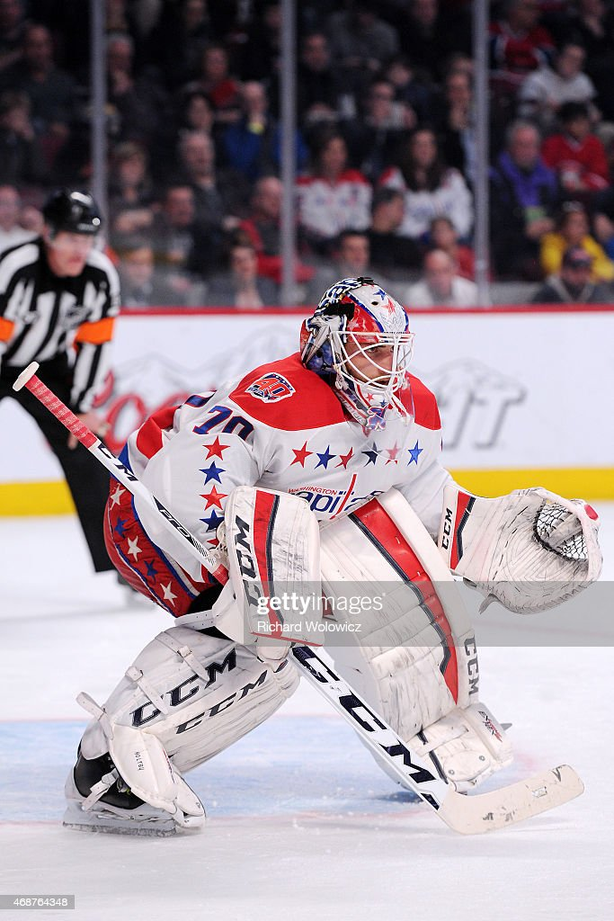 <a gi-track='captionPersonalityLinkClicked' href=/galleries/search?phrase=Braden+Holtby&family=editorial&specificpeople=5370964 ng-click='$event.stopPropagation()'>Braden Holtby</a> #70 of the Washington Capitals watches play during the NHL game against the Montreal Canadiens at the Bell Centre on April 2, 2015 in Montreal, Quebec, Canada.