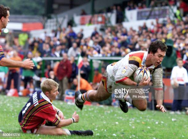 Bradford Bulls' Daniel Gartner is tripped over by London Broncos' Tulsen Tollett during the Tetley's Bitter Super League game at Welford Road...