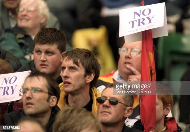 A Bradford Bulls fan sticks his 'No Try' sign on the top of his umbrella