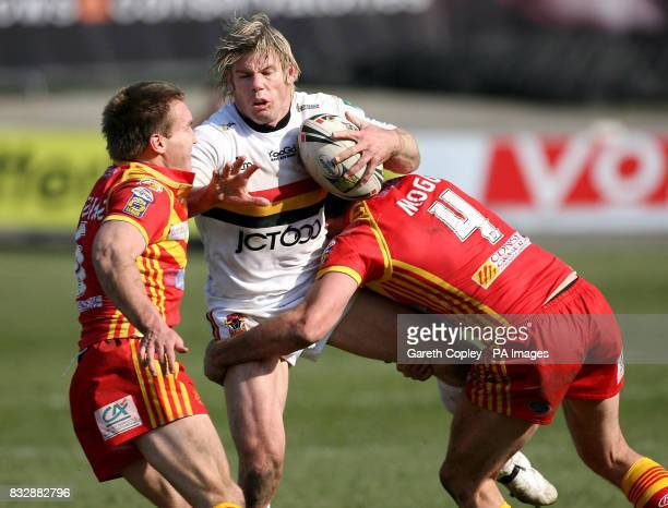 Bradford Bulls' Glenn Morrison is tackled by Catalan Dragons' Casey McGuire and Adam Mogg during their Engage Super League match at the Odsal Stadium...