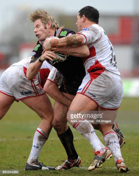 Bradford Bulls' Glenn Morrison is tackled by Hull KR's Paul Cooke and Ben Galea during the engage Super League match at Craven Park Hull