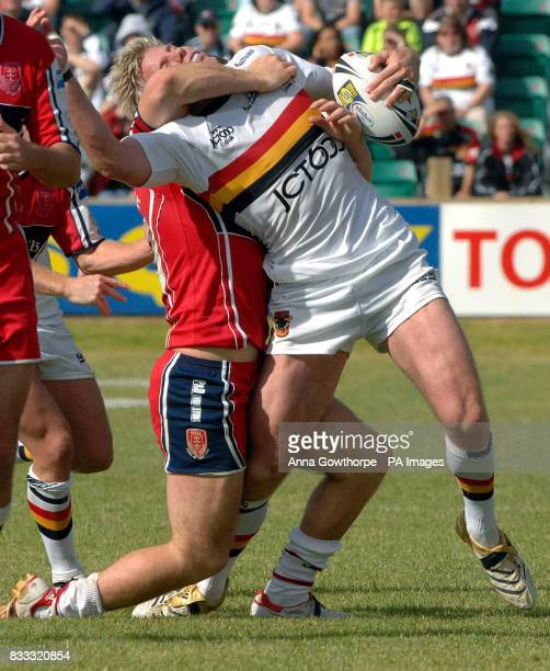 Bradford Bulls' Glenn Morrison under a strong challenge from Hull KR's Rhys Lovegrove during the Engage Super League match at Craven Park Stadium Hull