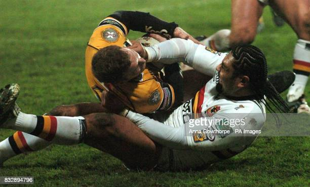 Bradford Bulls' Lesley Vainikolo puts in a strong challenge on Castleford's Mike Wainwright during the Carnegie Challenge Cup fourth round match at...
