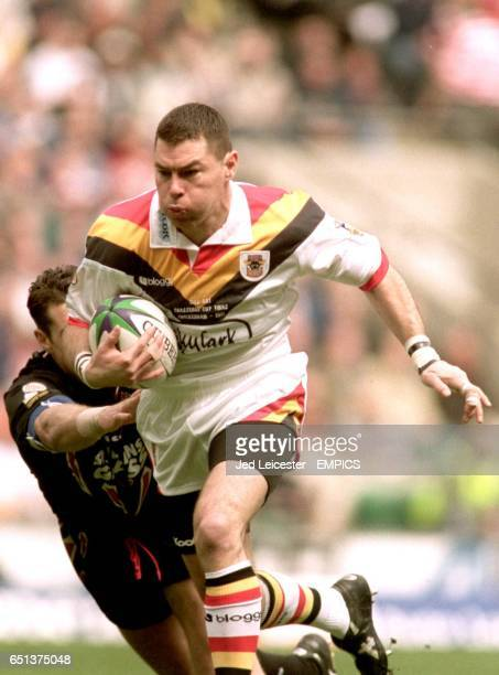 Bradford Bulls' Michael Withers charges through the St Helens defence