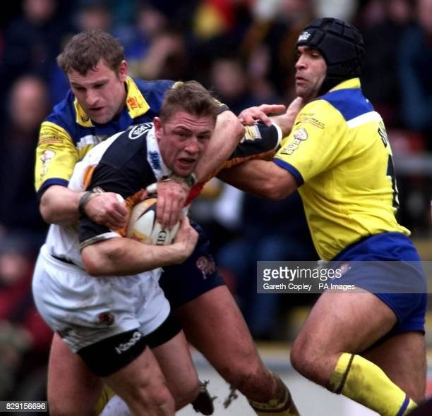 Bradford Bulls' Mike Forshaw is caught by Warrington Wolves' Kevin Crouthers and Sid Domic during the Bradford v Warrington Tetley's Bitter Super...