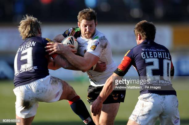 Bradford Bulls' Nick Scruton is tackled by Wakefield Trinity Wildcats' Glenn Morrison and Ben Gledhill during the Engage Super League match at Odsal...