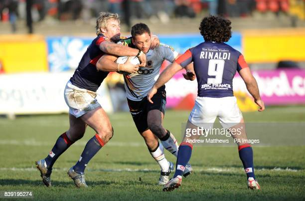 Bradford Bulls' Olivier Elima is tackled by Wakefield Trinity Wildcats' Julien Rinaldi and Glenn Morrison during the Engage Super League match at...