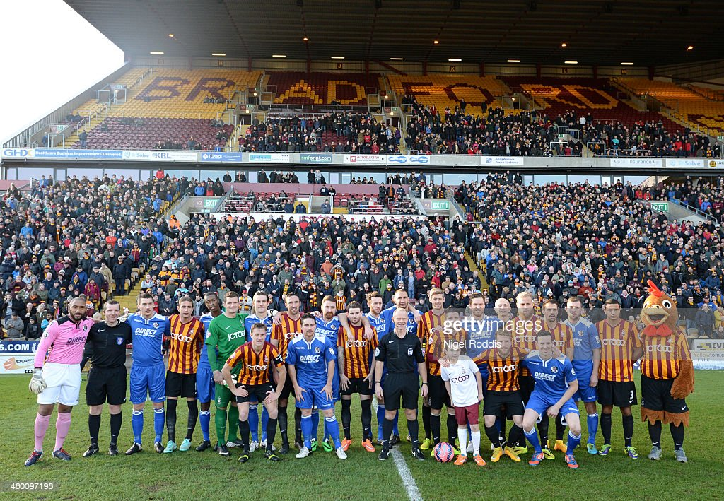 Bradford City and Dartford players pose for a group photograph in rememberance of World War I ahead of the FA Cup Second Round football match between Bradford City and Dartford at Coral Windows Stadium, Valley Parade on December 7, 2014 in Bradford, England.