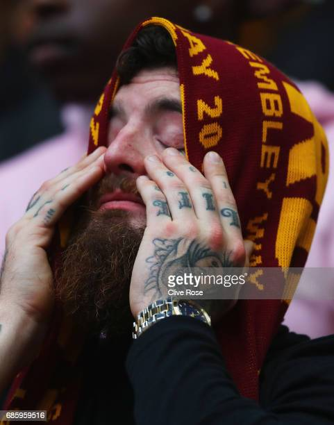 Bradford City fan looks dejected during the Sky Bet League One Playoff Final between Bradford City and Millwall at Wembley Stadium on May 20 2017 in...