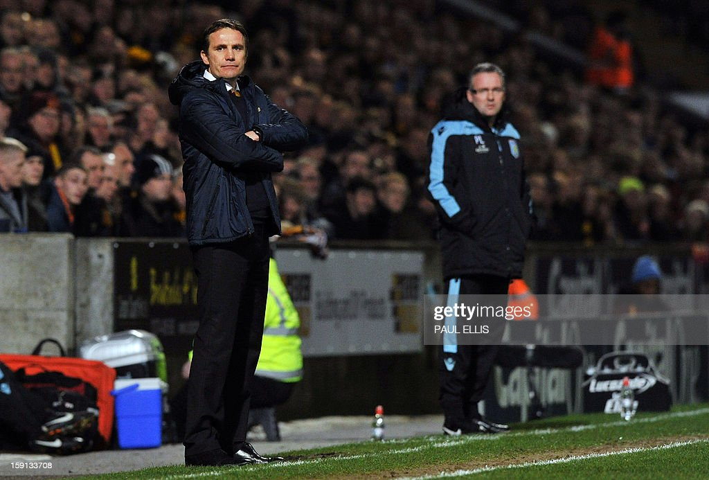 "Bradford City manager Phil Parkinson (L) and Aston Villa manager Paul Lambert (R) attend the English League Cup first leg semi-final football match between Bradford City and Aston Villa at The Coral Windows Stadium in Bradford, England, on January 8, 2013. Bradford won the match 3-1. USE. No use with unauthorized audio, video, data, fixture lists, club/league logos or ""live"" services. Online in-match use limited to 45 images, no video emulation. No use in betting, games or single club/league/player publications."
