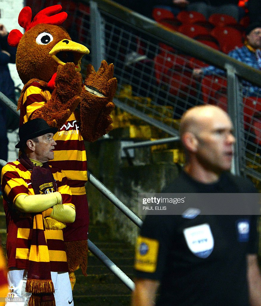 "A Bradford City mascot attends the English League Cup first leg semi-final football match between Bradford City and Aston Villa at The Coral Windows Stadium in Bradford, England, on January 8, 2013. Bradford won the match 3-1. USE. No use with unauthorized audio, video, data, fixture lists, club/league logos or ""live"" services. Online in-match use limited to 45 images, no video emulation. No use in betting, games or single club/league/player publications."