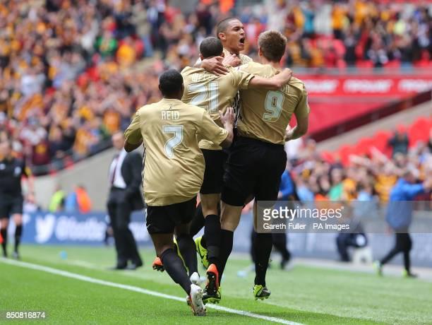 Bradford city players celebrate after Nahki Wells scores a goal