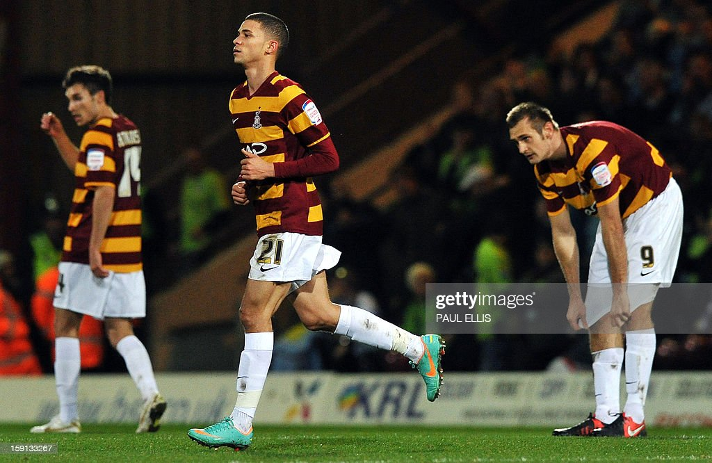 "Bradford City's Bermudian forward Nahki Wells (C) celebrates after scoring a goal against Aston Villa during the English League Cup football match between Bradford City and Aston Villa at The Coral Windows Stadium in Bradford, England, on January 8, 2013. Bradford won the match 3-1. USE. No use with unauthorized audio, video, data, fixture lists, club/league logos or ""live"" services. Online in-match use limited to 45 images, no video emulation. No use in betting, games or single club/league/player publications."