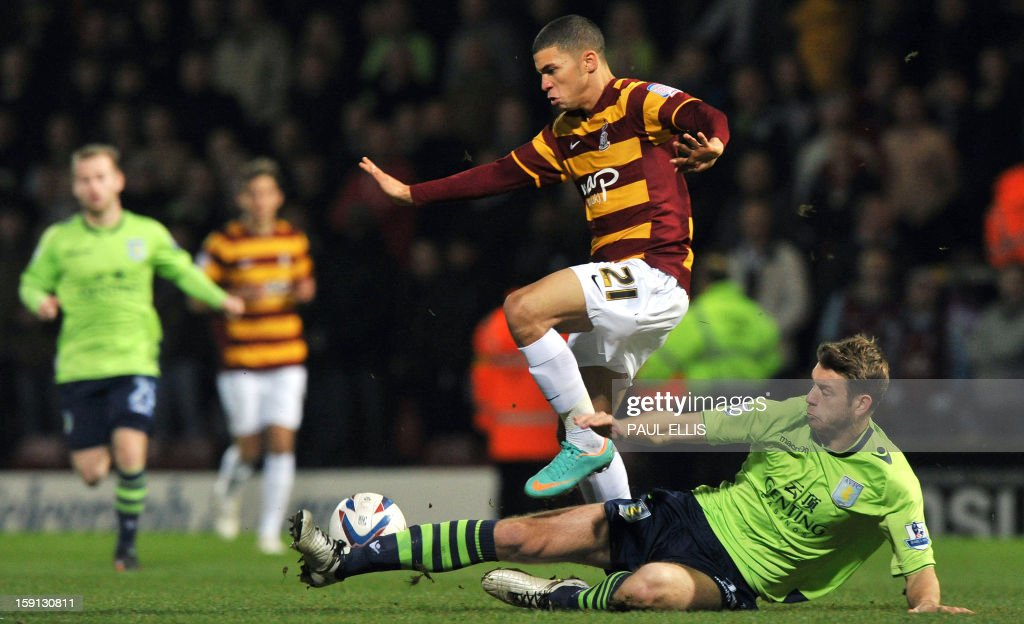 """Bradford City's Bermudian forward Nahki Wells (L) is challenged by Aston Villa's English defender Nathan Baker during the English League Cup football match between Bradford City and Aston Villa at The Coral Windows Stadium in Bradford, England, on January 8, 2013. USE. No use with unauthorized audio, video, data, fixture lists, club/league logos or """"live"""" services. Online in-match use limited to 45 images, no video emulation. No use in betting, games or single club/league/player publications."""