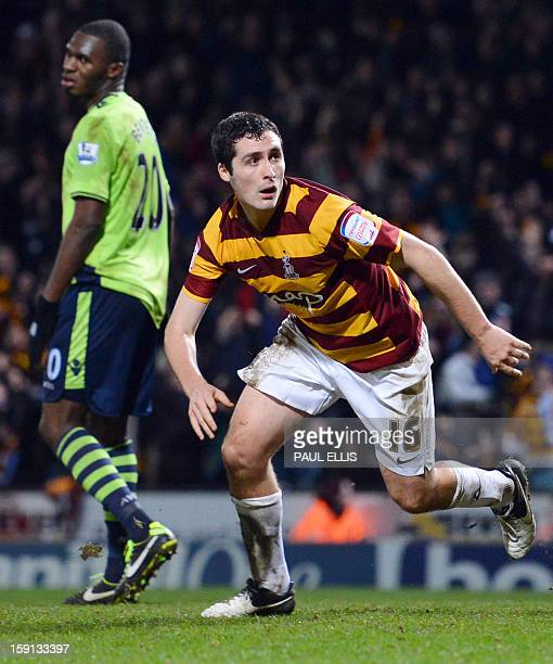 Bradford City's Irish defender Carl McHugh scores the third goal against Aston Villa during the English League Cup football match between Bradford...