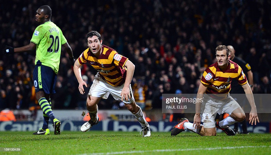 "Bradford City's Irish defender Carl McHugh (C) scores the third goal against Aston Villa during the English League Cup football match between Bradford City and Aston Villa at The Coral Windows Stadium in Bradford, England, on January 8, 2013. Bradford won the match 3-1. USE. No use with unauthorized audio, video, data, fixture lists, club/league logos or ""live"" services. Online in-match use limited to 45 images, no video emulation. No use in betting, games or single club/league/player publications."