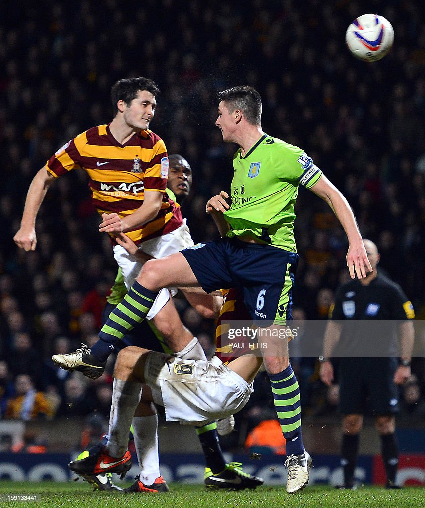 """Bradford City's Irish defender Carl McHugh (L) scores the third goal against Aston Villa during the English League Cup football match between Bradford City and Aston Villa at The Coral Windows Stadium in Bradford, England, on January 8, 2013. Bradford won the match 3-1. USE. No use with unauthorized audio, video, data, fixture lists, club/league logos or """"live"""" services. Online in-match use limited to 45 images, no video emulation. No use in betting, games or single club/league/player publications."""