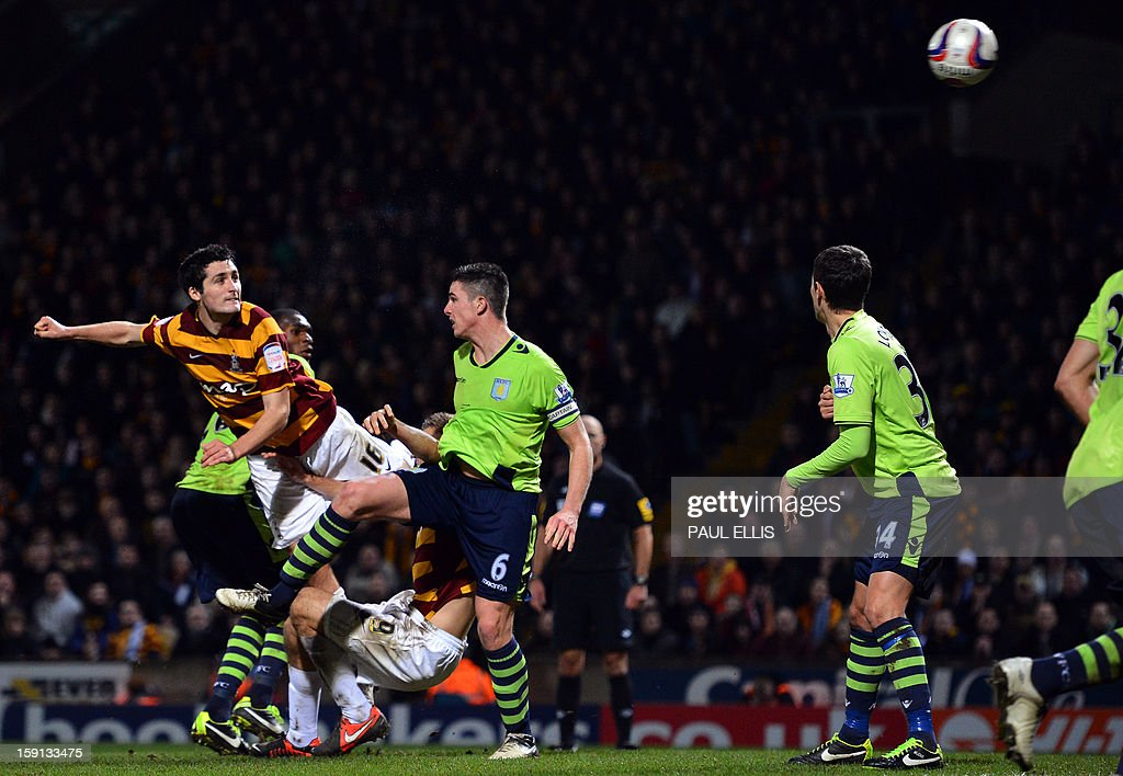 "Bradford City's Irish defender Carl McHugh (L) scores the third goal against Aston Villa during the English League Cup football match between Bradford City and Aston Villa at The Coral Windows Stadium in Bradford, England, on January 8, 2013. Bradford won the match 3-1. USE. No use with unauthorized audio, video, data, fixture lists, club/league logos or ""live"" services. Online in-match use limited to 45 images, no video emulation. No use in betting, games or single club/league/player publications."