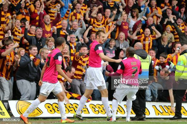 Bradford City's James Hanson celebrates scoring his teams second goal of the game in front of the away fans with teammates Kyel Reid and Nahki Wells