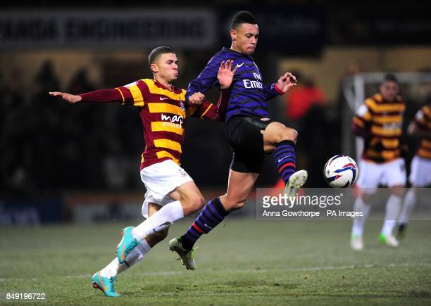 Bradford City's Nahki Wells and Arsenal's Francis Coquelin battle for the ball