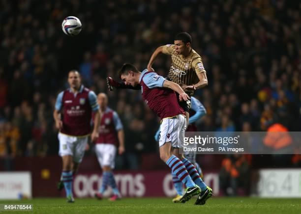 Bradford City's Nahki Wells and Aston Villa's Ciaran Clark battle for the ball