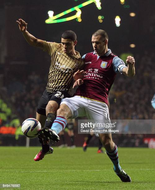 Bradford City's Nahki Wells and Aston Villa's Ron Vlaar battle for the ball