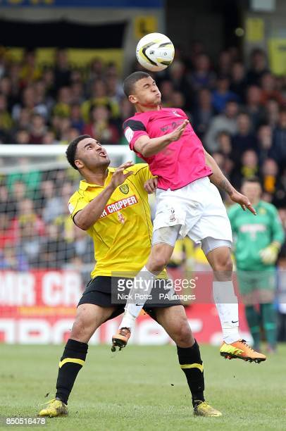 Bradford City's Nahki Wells and Burton Albion's Marcus Holness battle for the ball