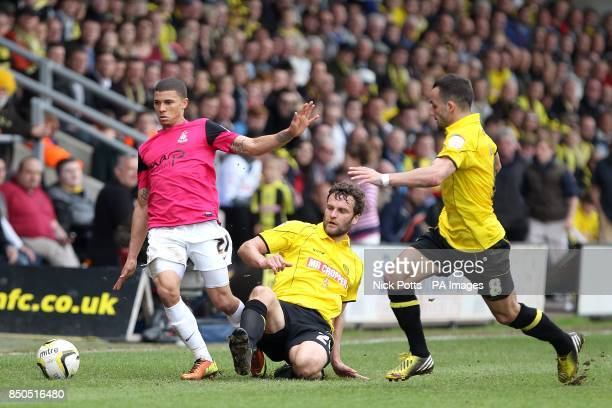 Bradford City's Nahki Wells battles for the ball with Burton Albion's Ian Sharps and Robbie Weir
