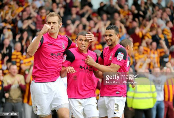 Bradford City's Nahki Wells celebrates scoring his teams third goal of the game with teammates James Meredith and James Hanson