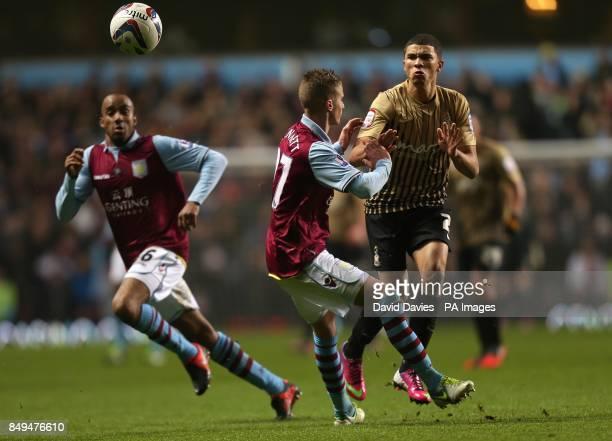Bradford City's Nahki Wells gets blocked by Aston Villa's Joe Bennett