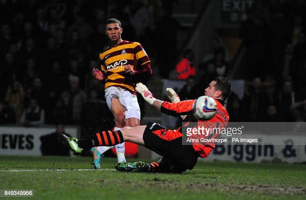 Bradford City's Nahki Wells scores his side's first goal during the Capital One Cup Semi Final First Leg match at the Coral Windows Stadium Bradford
