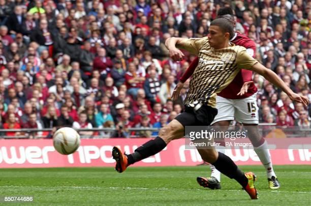 Bradford City's Nahki Wells scores his side's third goal of the game